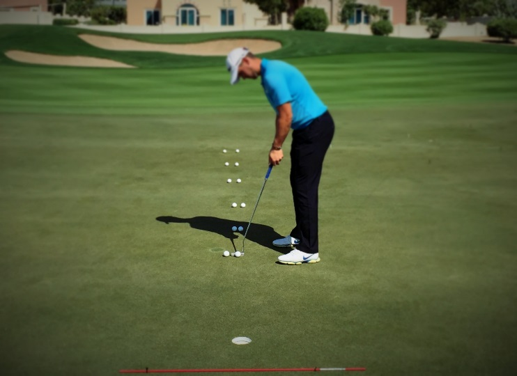 competitive practice game on putting green
